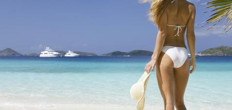 image-Woman-on-tropical-beach-with-yacht.jpg